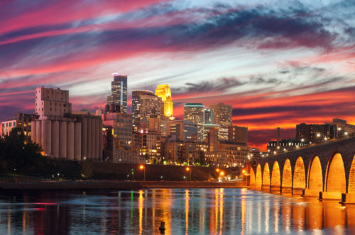 Minneapolis downtown skyline during majestic sunset.