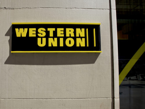 An image of the Western Union logo outside of a store.