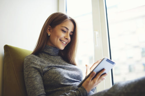 A woman using a banking app on a mobile device.