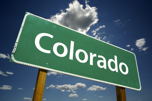 """A green road sign that reads """"Colorado."""""""