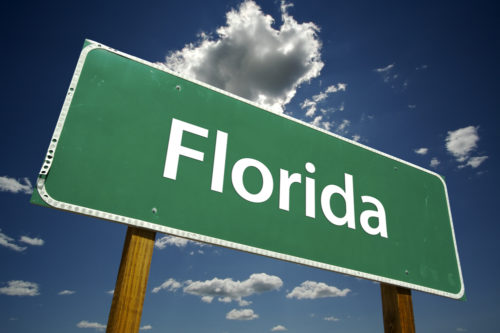 """A road sign that reads """"Florida."""""""