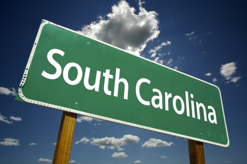 """A road sign that reads """"South Carolina."""""""