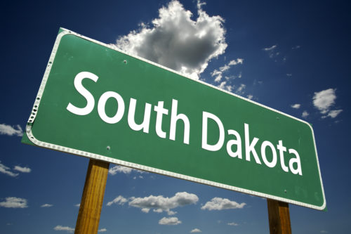 "A road sign that reads ""South Dakota."""