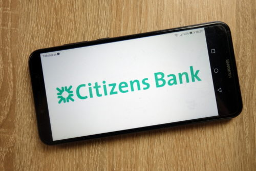 A smartphone displays the Citizens Bank website.