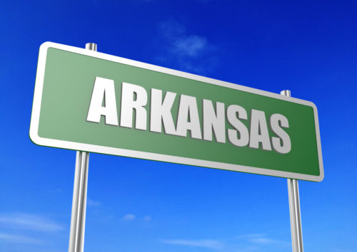 """A graphic of a road sign that reads """"Arkansas."""""""