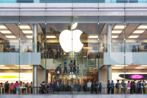 An image of the exterior of a busy Apple store.