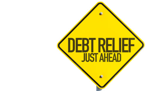 """A yellow caution sign reads """"debt relief just ahead."""""""