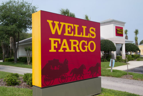 An image of the Wells Fargo sign outside of its bank branch.