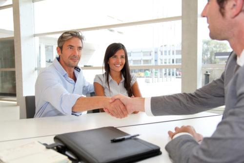 A couple negotiating a no bank account loan with a bank representitive.