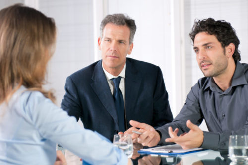 A banker speaking with some clients.