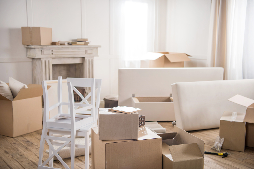 An apartment is filled with boxes in the process of moving out.