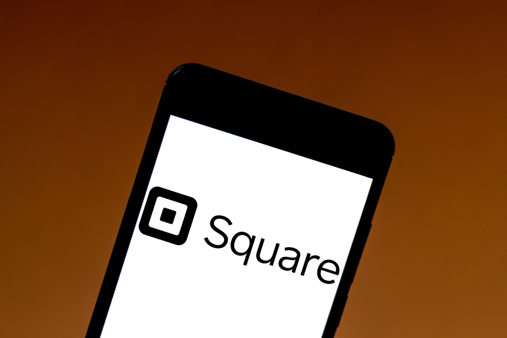 A phone is open to the Square app.