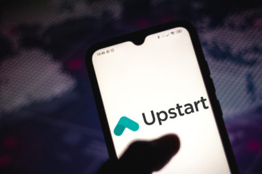 A phone is open to the Upstart app.