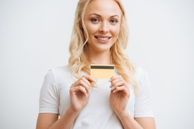 A person holding their credit card.